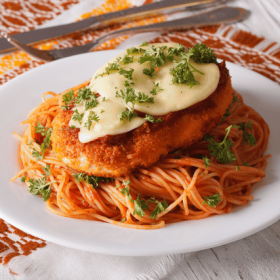 Scatter parmigiana /Parmesan cheese over sauce; cover dish and bake at degrees for half an hour (30 minutes). Put mozzarella slices on chicken and bake until cheese is melted (approx. 10 minutes).Cuisine: Italian.