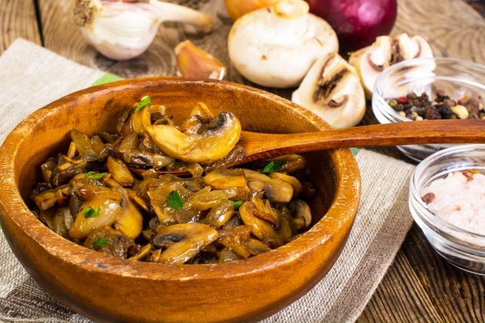 sauteed mushrooms in wooden bowl