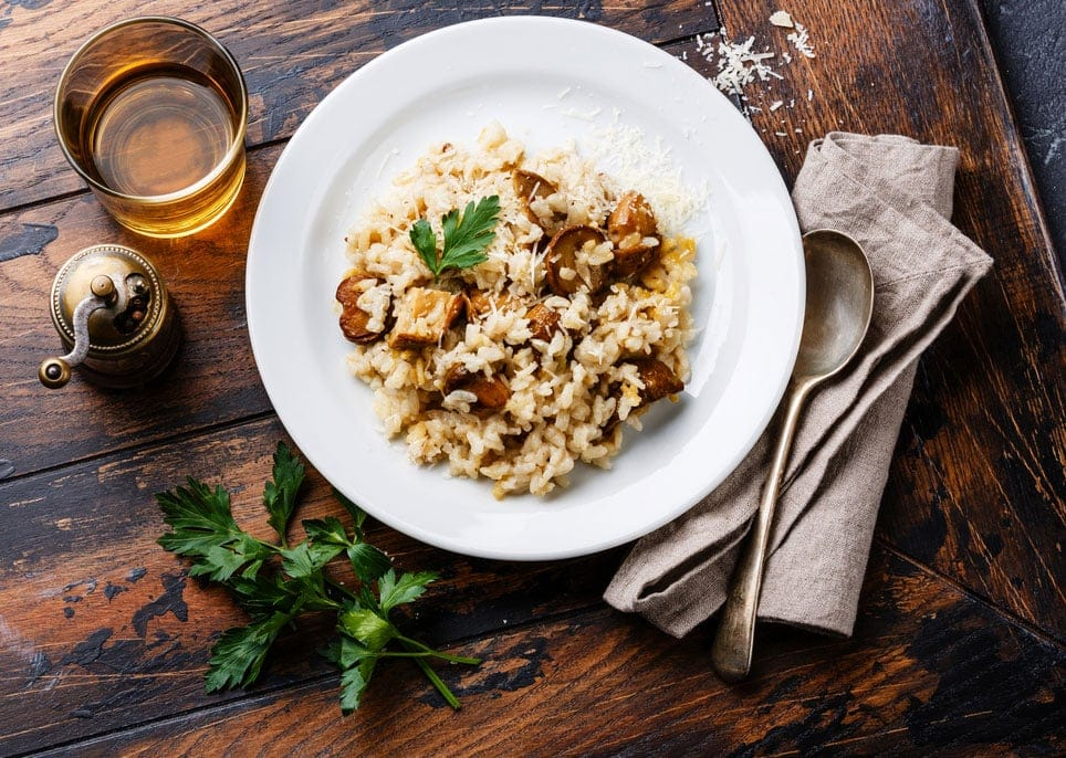 Risotto with porcini mushroom on wooden table